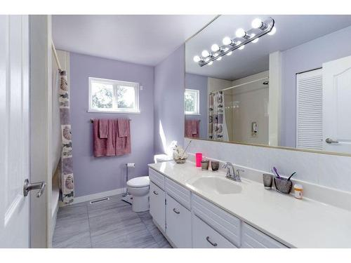 Another purple room is the main bathroom upstairs with very old finishing and short counter