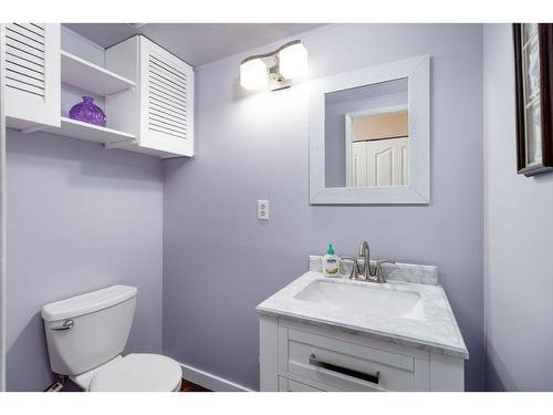 Guest bathroom on main level that is very purple and will need to be painted