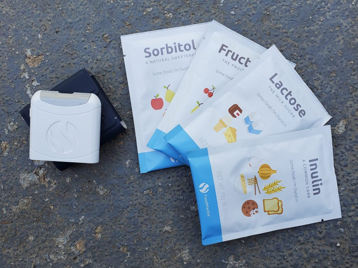 FoodMarble AIRE device and the FODMAP kit packets