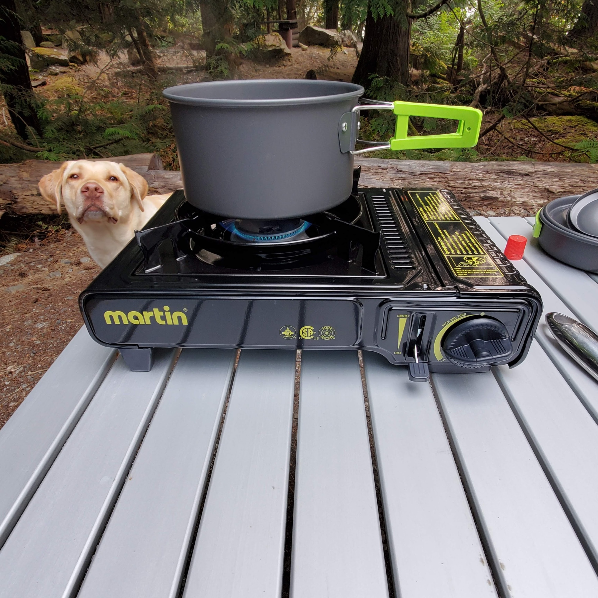 Showing the Martin camping stove with pot sitting on top